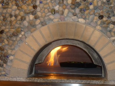 PIZZA BAKED ON IN OUR ROTATING GAS/WOOD  STONE OVEN  ~~~ 