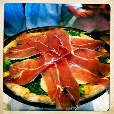 OUR FAMOUS CRUDO RUCULA AND GRANA PIZZA